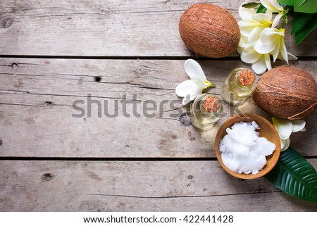 Coconuts and coconut oil on  vintage wooden background. Selective focus. Flat lay. Natural organic spa products. Place for text.  - stock photo