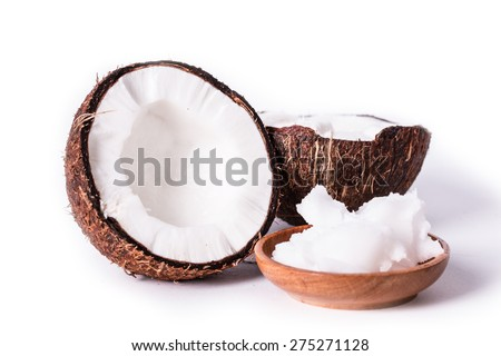 coconuts and oil on wooden table - stock photo