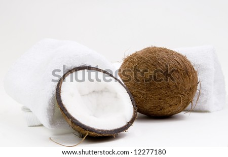 Coconuts and white towels on white background