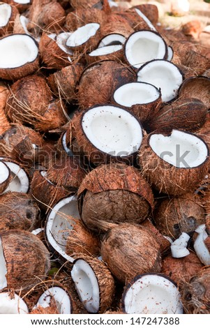 Coconuts cut in half, coconut shell - stock photo