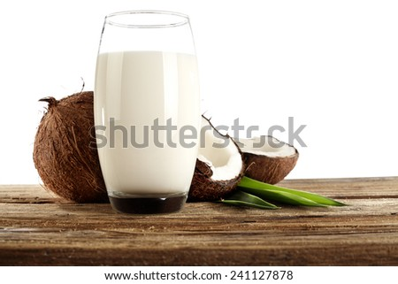 coconuts on desk and leaf  - stock photo
