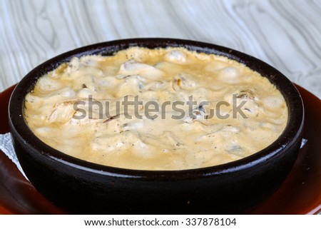 Cocotte julienne with mushrooms, chicken, cream and cheese - stock photo