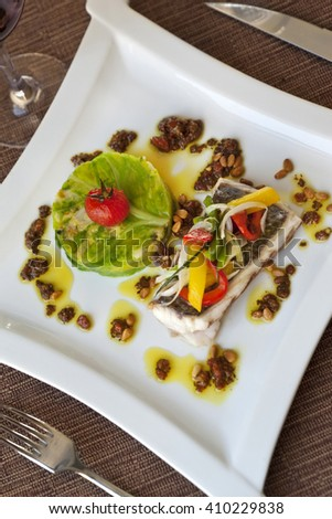 Cod fillet, green cabbage and peppers on a plate - stock photo