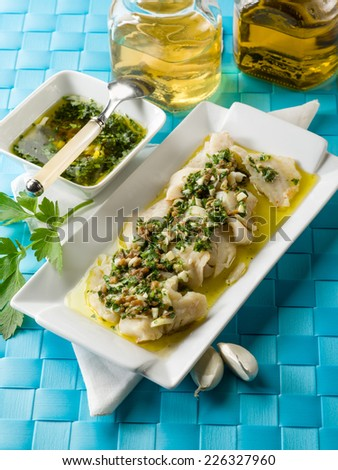 cod fillet  marinated with parsley anchovy and garlic - stock photo