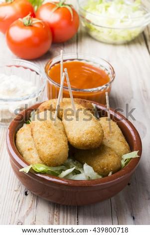 cod fish croquettes on dish - stock photo