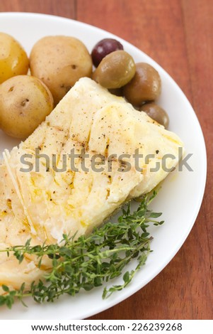 cod fish with olives and potato - stock photo