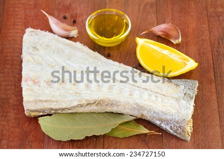 cod fish with rosemary, oil and garlic - stock photo