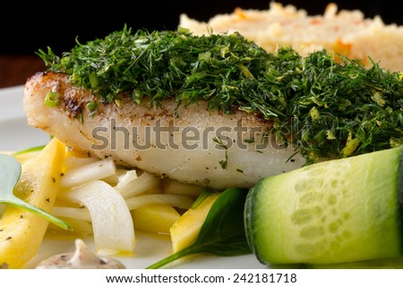 cod fish with vegetables - stock photo