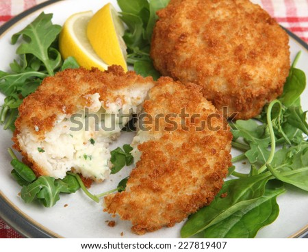 Cod fishcakes with rocket, spinach and watercress salad.