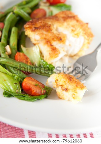 Cod Fried  in Coconut Flakes Served with Sauteed Vegetables - stock photo
