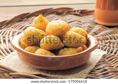 Cod fritters, traditional Spanish tapas Bunuelos de Bacalao - stock photo