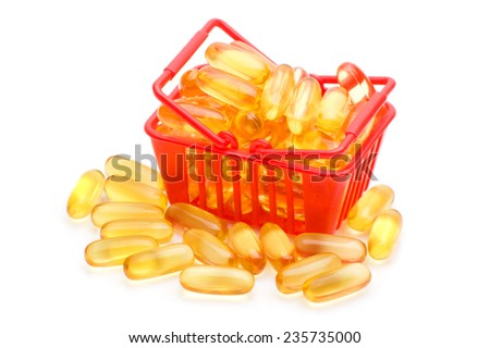 Cod liver oil Omega 3 gel capsules in the shopping basket, isolated on white background - stock photo