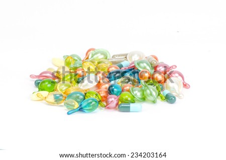 Cod liver oil omega 3 gel capsules isolated on pastel background - stock photo