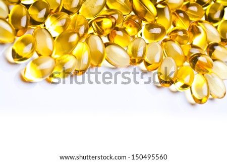 Cod liver oil omega 3 gel capsules isolated on pastel background. Vitamin d pils. pharmaceutical industry - stock photo