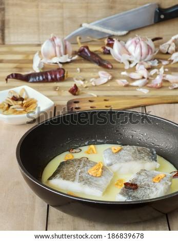 Cod with pil-pil sauce (Bacalao al pil pil), Basque cookery. - stock photo
