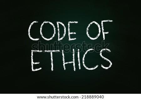 Code of Ethics illustration of chalk writing on blackboard - stock photo