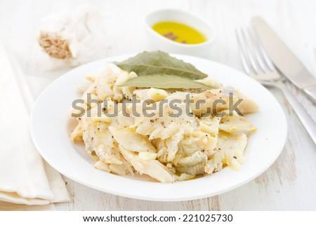 codfish on plate - stock photo