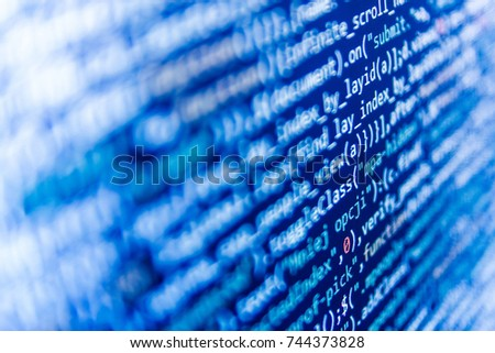 Coding script text on screen. Website programming code. Big data storage and cloud computing representation. Webdesigner Workstation. Big data database app. IT coding on monitor screen.