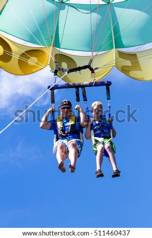 Coeur d' Alene, Idaho - August 12: Parasailing adventure with people enjoying the view. August 12 2016, Coeur d' Alene, Idaho.