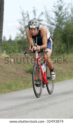 COEUR D'ALENE, IDAHO, JUNE 21: Triathlete Gergely Nagy of Budapest, Hungary on the bike portion of the Coeur d'Alene Ironman Triathlon in northern Idaho on June 21, 2009, - stock photo