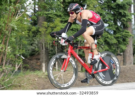 COEUR D'ALENE, IDAHO, JUNE 21: Triathlete James Bonney of Austin, TX on the bike portion of the Coeur d'Alene Ironman Triathlon in northern Idaho on June 21, 2009,