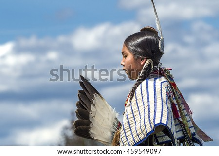 Coeur d'Alene, Idaho USA - 07-23-2016. Side view of Native American against blue sky. Young dancer participates in the Julyamsh Powwow on July 23, 2016 in Coeur d'Alene, Idaho.