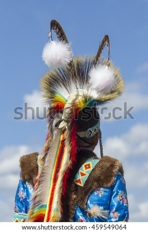 Coeur d'Alene, Idaho USA - 07-23-2016. The back of a boy's headdress. Young dancer participates in the Julyamsh Powwow on July 23, 2016 in Coeur d'Alene, Idaho.
