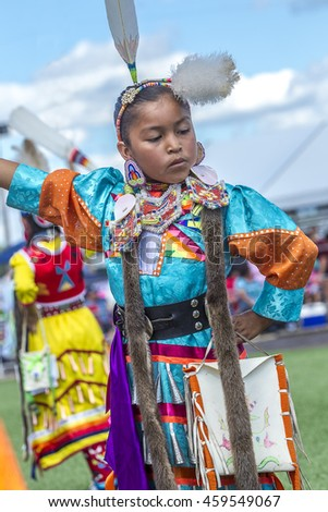 Coeur d'Alene, Idaho USA - 07-23-2016. Young female dancer at powwow. Young dancer participates in the Julyamsh Powwow on July 23, 2016 in Coeur d'Alene, Idaho.
