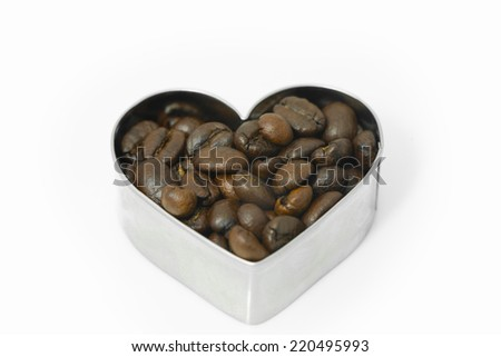 cofee beans on heart  shape box isolated on white background