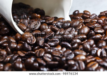 coffe and a cup with smoke as background - stock photo