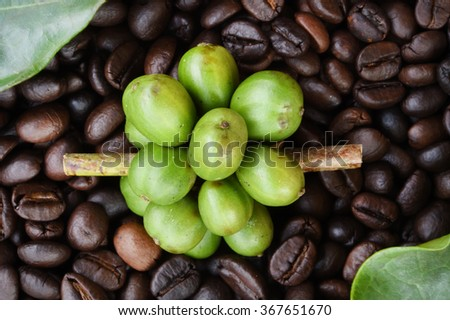Coffe beans and fresh berries coffee beans on wooden backgourng  - stock photo