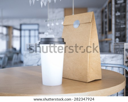 Coffe cup and paper bag on table. 3d rendering - stock photo