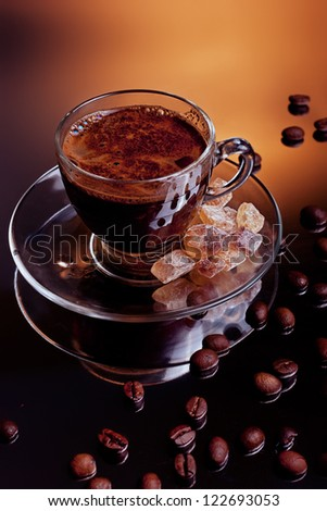 Coffe cup with beans and brown sugar aside