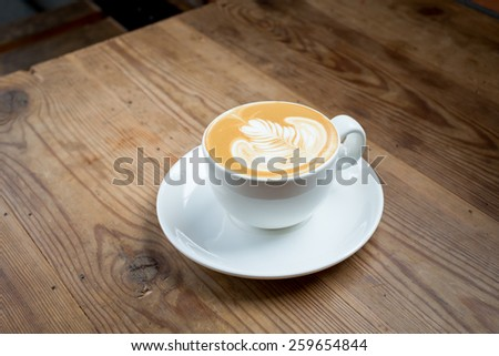 coffe latte cup on a wood table - stock photo