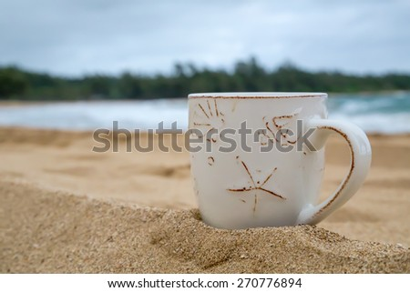 Coffe mug on hawaiian beach, relaxation concept - stock photo