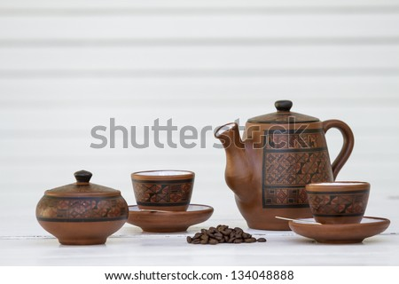 Coffe set, cup, beans, sugar, kettle in white environment. white background. Isolated. Tea time. Sample text. Expresso. - stock photo