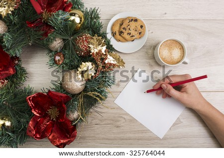 Coffee and a chocolate chip cookies with a Christmas decor on the wooden background - stock photo