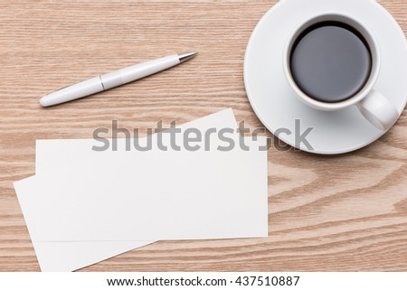 coffee and business card on wooden background.