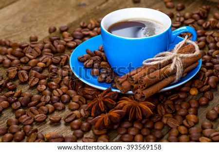 Coffee and coffee bean on wood background