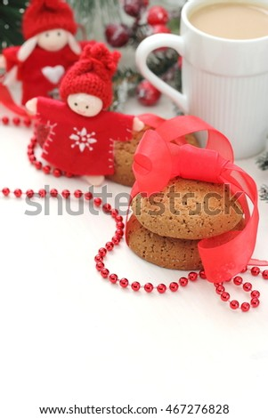 Coffee and cookies in christmas decoration.