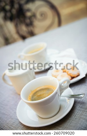 Coffee and cookies on the table, outdoor - small focus - stock photo