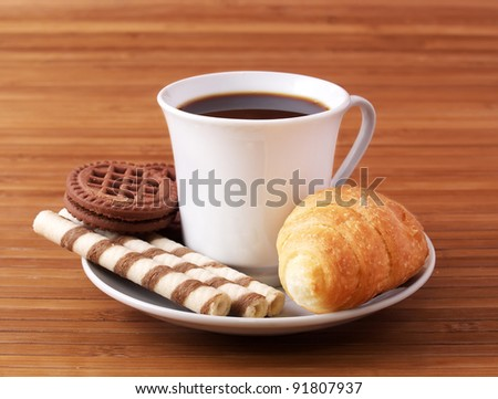 Coffee and croissant. Abstract composition - stock photo