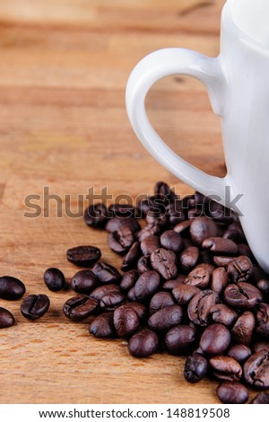 Coffee and cup on wooden background - stock photo