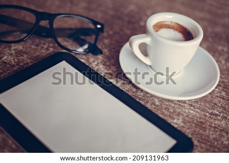 Coffee And Digital Tablet On Work Desk