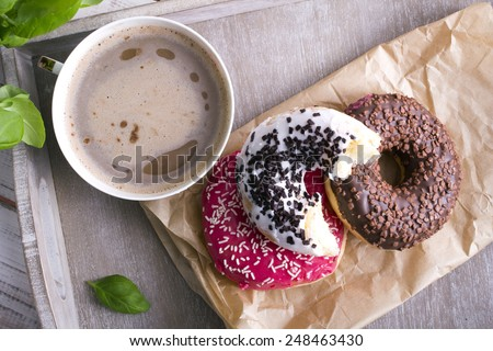 coffee and donut on wood background - stock photo