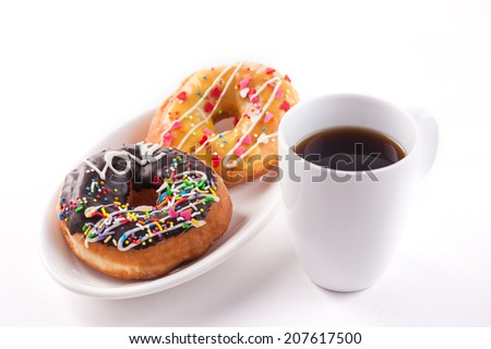 coffee and donuts for breakfast - stock photo