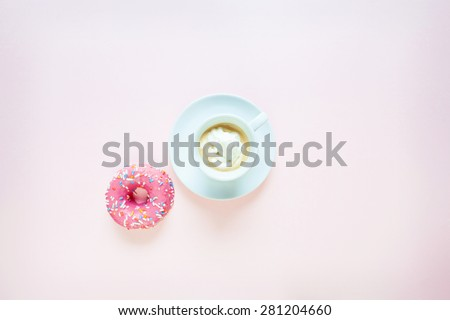 Coffee and donuts on pink background - stock photo