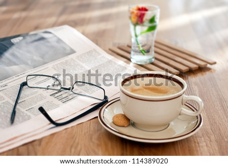 Coffee and financial newspaper in the morning - stock photo