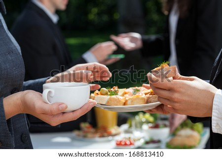 Coffee and fresh sandwiches at lunch break - stock photo