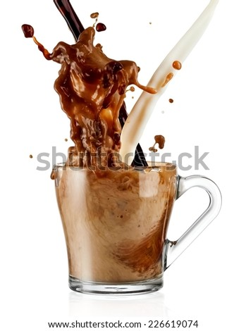 Coffee and milk pour and splash in a glass - stock photo